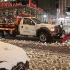 Sanitation workers shovel snow from the streets of Times Square Wednesday, Nov. 7, 2012, in New York. Coastal residents of New York and New Jersey faced new warnings to evacuate their homes and airlines canceled hundreds of flights as a new storm arrived Wednesday, only a week after Superstorm Sandy left dozens dead and millions without power. (AP Photo/Frank Franklin II)
