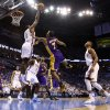Oklahoma City\'s Serge Ibaka blocks the shot of Los Angeles\' Ramon Sessions during Game 2 in the second round of the NBA playoffs between the Oklahoma City Thunder and the L.A. Lakers at Chesapeake Energy Arena on Tuesday, May 15, 2012, in Oklahoma City, Oklahoma. Photo by Chris Landsberger, The Oklahoman