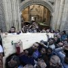 Muslim Brotherhood and Egyptian President Morsi supporters carry two bodies who were killed during Wednesday\'s clashes during their funeral outside Al Azhar mosque, the highest Islamic Sunni institution, Friday, Dec. 7, 2012. During the funeral, thousands Islamist mourners chanted,