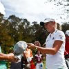 Photo -   LPGA pro Stacy Lewis, right, signs autographs before she tees off during day two of pro-am action at the CME Group Titleholders on Wednesday Nov. 14, 2012, at Twin Eagles Golf Club in Naples, Fla. (AP Photo/Naples Daily News, Scott McIntyre) FORT MYERS OUT.