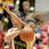 Photo - Iowa State forward Hallie Christofferson fouls Baylor guard Makenzie Robertson as they vie for a rebound during the first half of an NCAA college basketball game in Ames, Iowa, Tuesday, March 4, 2014. (AP Photo/Justin Hayworth)