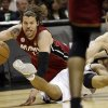 Photo - Miami Heat shooting guard Mike Miller, San Antonio Spurs point guard Cory Joseph and Matt Bonner, right, battle for a loose ball during the first half at Game 3 of the NBA Finals basketball series, Tuesday, June 11, 2013, in San Antonio. (AP Photo/Eric Gay)