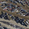 This Friday, Jan. 18, 2013 aerial photo shows some of thousands of cars motorcycles, bottom center, which were damaged in the Oct. 29, 2012 Superstorm Sandy and stored on the runways at Calverton Executive Airpark in Calverton, N.Y. Environmentalists are decrying the placement of the 18,000 damaged automobiles at the defunct defense plant on eastern Long Island near the environmentally protected Pine Barrens. The town supervisor in Riverhead disputes the idea that there is any hazard. The town leased the runways to salvage companies and could reap up to $2.7 million under the lease agreement. (AP Photo/Mark Lennihan)