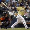 Milwaukee Brewers\' Caleb Gindl, right, hits a walkoff home run during the 13th inning of a baseball game against the Miami Marlins, Sunday, July 21, 2013, in Milwaukee. (AP Photo/Morry Gash)