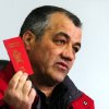 In this picture taken on Saturday, Jan. 12, 2013, Pero Ilieski, the mayor of Macedonia\'s southwestern village of Vevcani, shows the red passport of the Republic of Vevcani. These passports are to attract tourists rather than a serious secession drive. The Vevcani carnival has always been held on St. Vasilij\'s day for more than fourteen centuries, marking the arrival of the New Year by the Julian calendar. The carnival, which has pagan roots, highlights political satire, with masked local people acting out the current events. (AP Photo/Boris Grdanoski)