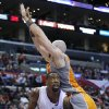 Los Angeles Clippers\' DeAndre Jordan, bottom, looks to shoot as Phoenix Suns\' Marcin Gortat, of Poland, defends during the first half of an NBA basketball game in Los Angeles, Saturday, Dec. 8, 2012. (AP Photo/Jae C. Hong)