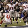 New York Giants running back Ahmad Bradshaw (44) rushes for a touchdown in front of New England Patriots linebacker Jerod Mayo (51) during the second half of the NFL Super Bowl XLVI football game, Sunday, Feb. 5, 2012, in Indianapolis. (AP Photo/Marcio Jose Sanchez) ORG XMIT: SB459