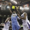 Photo - Denver Nuggets forward Kenneth Faried, center, grabs a rebound between Sacramento Kings' Aaron Gray, left, and Jason Thompson during the first quarter of an NBA basketball game in Sacramento, Calif., Sunday, Jan. 26, 2014. (AP Photo/Rich Pedroncelli)