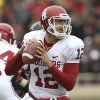 Oklahoma\'s Landry Jones looks to throw against Texas Tech during an NCAA college football game in Lubbock, Texas, Saturday, Oct. 6, 2012. (AP Photo/Lubbock Avalanche-Journal, Stephen Spillman) LOCAL TV OUT