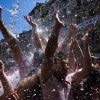 Revelers are sprayed with water thrown from balconies during the launch of the \'Chupinazo\' rocket, to celebrate the official opening of the 2013 San Fermin fiestas, Saturday, July 6, 2013 in Pamplona, Spain. Revelers from around the world kick off the San Fermin festival with a messy party in the Pamplona town square, one day before the first of eight days of the running of the bulls glorified by Ernest Hemingway\'s 1926 novel \'The Sun Also Rises\'. (AP Photo/Daniel Ochoa de Olza)