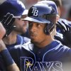 Photo - Tampa Bay Rays' Desmond Jennings celebrates with teammates in the dugout after hitting solo home run during the third inning of a baseball game against the Chicago Cubs in Chicago, Friday, Aug. 8, 2014. (AP Photo/Paul Beaty)