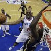 Photo - Philadelphia 76ers' Damien Wilkins (8) jumps for a shot as Indiana Pacers' Roy Hibbert (55) defends during the first half of an NBA basketball game on Saturday, March 16, 2013, in Philadelphia. (AP Photo/Matt Slocum)