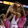 Maryland\'s Alicia DeVaughn, center, is sandwiched between Clemson\'s Jordan Gaillard, left, and Nyilah Jamison-Myers in the first half of an NCAA women\'s college basketball game, Sunday, Feb. 9, 2014, in College Park, Md. (AP Photo/Gail Burton)