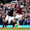 Photo - Southampton's Morgan Schneiderlin, left, and West Ham United's Guy Demel battle for the ball during the English Premier League soccer match at Upton Park, London, Saturday, Feb. 22, 2014. (AP Photo/PA, Anthony Devlin) UNITED KINGDOM OUT