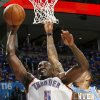 Oklahoma City\'s Kendrick Perkins Puts in a shot in front of Denver\'s Kenyon Martin during the first round NBA Playoff basketball game between the Thunder and the Nuggets at OKC Arena in downtown Oklahoma City on Wednesday, April 20, 2011. The Thunder beat the Nuggets 106-89 and lead the series 2-0. Photo by John Clanton, The Oklahoman