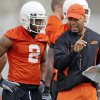 Photo - Running backs coach Robert Gillespie talks with OSU's Beau Johnson (2) during spring practice for the Oklahoma State University (OSU) college football team at the practice field in Stillwater, Okla., Monday, March 9, 2009. PHOTO BY NATE BILLINGS, THE OKLAHOMAN ORG XMIT: KOD