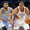 Oklahoma City\'s Thabo Sefolosha (2) tries to get past Denver\'s Wilson Chandler (21) during the first round NBA playoff game between the Oklahoma City Thunder and the Denver Nuggets on Sunday, April 17, 2011, in Oklahoma City, Okla. Photo by Chris Landsberger, The Oklahoman