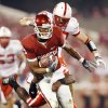 Nebraska\'s Blake Lawrence (40) and Armando Murillo (6) try to bring own OU\'s Juaquin Iglesias (9) during the second half of the college football game between the University of Oklahoma Sooners (OU) and the University of Nebraska Huskers (NU) at the Gaylord Family-Oklahoma Memorial Stadium, on Saturday, Nov. 1, 2008, in Norman, Okla. BY NATE BILLINGS, THE OKLAHOMAN
