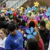 Spinning flowers are raised in the air before beginning the 2012 Oklahoma City Walk to End Alzheimer\'s at Bricktown Ballpark in Oklahoma City, OK, Saturday, September 15, 2012, By Paul Hellstern, The Oklahoman