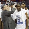 NCAA TOURNAMENT / COLLEGE BASKETBALL / ELITE 8 / UNIVERSITY OF OKLAHOMA / OU: North Carolina coach Roy Williams puts a championship hat onto Ty Lawson as the Tar Heels celebrate the 72-60 win over Oklahoma in the Elite Eight game of NCAA Men\'s Basketball Regional between the University of North Carolina and the University of Oklahoma at the FedEx Forum on Sunday, March 29, 2009, in Memphis, Tenn. PHOTO BY CHRIS LANDSBERGER, THE OKLAHOMAN ORG XMIT: KOD