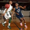 Photo - Southmoore's Serithia Hawkins, left,  and Muskogee's Sydni Carter go for a loose ball in the girls championship game of the John Nobles Invitational Tournament on Saturday, Jan. 26, 2013  in Moore, Okla. Photo by Steve Sisney, The Oklahoman