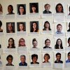 Photo - Photos of newly hired reporters are seen in the newsroom of the Orange County Register in Santa Ana, Calif., Thursday, Dec. 27, 2012. After years of demoralizing layoffs, one newspaper is trying something novel: hiring more reporters. The Orange County Register's new owner thinks the way to turn the paper around is through better reporting to lure new and former readers to a revived product. (AP Photo/Jae C. Hong)