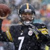 Photo - In the falling snow, Pittsburgh Steelers quarterback Ben Roethlisberger (7) throws a pass during the first quarter of an NFL football game against the Miami Dolphins in Pittsburgh, Sunday, Dec. 8, 2013. (AP Photo/Tom E. Puskar)