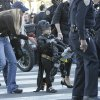 Batkid, Miles Scott, 5, walks away under a police escort with all his goodies after appearing at a rally at City Hall in San Francisco on Friday, Nov. 15, 2013. Miles is a leukemia survivor from Tulelake in Siskiyou County. After battling leukemia since he was a year old, Miles is now in remission. One of his heroes is Batman. To celebrate the end of this treatment, the Make-A-Wish Greater Bay Area granted his wish to become Batkid for a day. (AP Photo/Bay Area News Group, Gary Reyes)