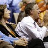 Tennessee Gov. Bill Haslam, right, cheers as he sits with Pat Summitt, left, Tennessee head coach emeritus, in the first half of an NCAA basketball game between Tennessee and Vanderbilt, Thursday, Jan. 24, 2013, in Nashville, Tenn. (AP Photo/Mark Humphrey)
