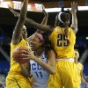 UCLA forward Atonye Nyingifa, center, is defended by California center Talia Caldwell, left, and forward Gennifer Brandon during the second half of an NCAA women\'s basketball game in Los Angeles, Friday, Feb. 15, 2013. California won 79-51. (AP Photo/Jae C. Hong)