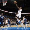 Oklahoma City\'s James Harden (13) takes a shot in the first half during an NBA basketball game between the Oklahoma City Thunder and the Dallas Mavericks at Chesapeake Energy Arena in Oklahoma City, Thursday, Dec. 29, 2011. Photo by Nate Billings, The Oklahoman