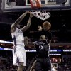 Charlotte Bobcats\' Michael Kidd-Gilchrist (14) dunks on Brooklyn Nets\' Gerald Wallace (45) during the second half of an NBA basketball game in Charlotte, N.C., Wednesday, March 6, 2013. The Nets won 99-78. (AP Photo/Bob Leverone)