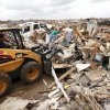 A front loader picks up debris in the Westmoor addition, Sunday, May 26, 2013. Photo by David McDaniel, The Oklahoman