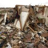 Photo - An above ground safe room under the rubble of this destroyed home in Moore, OK, is still standing after taking the impact of May 20th's EF5 tornado. Thursday, May 30, 2013,  Photo by Paul Hellstern, The Oklahoman <strong>PAUL HELLSTERN</strong>