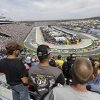 Fans watch the start of the STP 500 NASCAR Sprint Cup series auto race at Martinsville Speedway in Martinsville, Va., Sunday April 7, 2013. (AP Photo/Steve Helber)