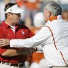 Photo - OU head coach Bob Stoops, left, and Texas head coach Mack Brown shake hands before the Red River Rivalry college football game between the University of Oklahoma Sooners (OU) and the University of Texas Longhorns (UT) at the Cotton Bowl in Dallas, Texas, Saturday, Oct. 17, 2009. Photo by Nate Billings, The Oklahoman ORG XMIT: KOD