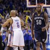 Oklahoma City\'s Derek Fisher (6) and Reggie Jackson (15) celebrate the 93-91 win in front of Memphis\' Zach Randolph (50) during the second round NBA playoff basketball game between the Oklahoma City Thunder and the Memphis Grizzlies at Chesapeake Energy Arena in Oklahoma City, Sunday, May 5, 2013. Photo by Chris Landsberger, The Oklahoman