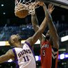 Toronto Raptors\' Amir Johnson (15) dunks over Phoenix Suns\' Markieff Morris (11) during the first half of an NBA basketball game, Wednesday, March 6, 2013, in Phoenix. (AP Photo/Matt York)