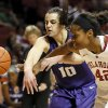 Oklahoma\'s Kaylon Williams (42) and Kansas State\'s Leticia Romero (10) chase the ball in the first half during an NCAA women\'s basketball game between the Oklahoma Sooners (OU) and the Kansas State Wildcats at Lloyd Noble Center in Norman, Okla., Saturday, Jan. 11, 2014. Photo by Nate Billings, The Oklahoman