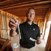 Homebuilder Curtis McCarty shows an anchor bolt and high-wind strapping bracket features recommended by FEMA at 4748 Ridgeline on Thursday, August 18, 2011, in Norman, Okla. Photo by Steve Sisney, The Oklahoman