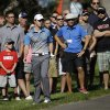 Photo - Rory McIlroy, of Northern Ireland, reacts after hitting from the rough on the 13th hole during the second round of the Memorial golf tournament Friday, May 30, 2014, in Dublin, Ohio. (AP Photo/Darron Cummings)