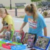 Erin Drewke, 13, and her sister Kara, 17, set up their booth of handmade items at the Edmond Youth Market during the Wednesday Farmer\'s Market, Wednesday, June 1, 2011. The Drewke\'s are starting a business called 2 Busy Chicks Designs. Photo by David McDaniel, The Oklahoman