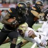 Oklahoma State wide receiver Tyreek Hill (24) looks for running room on a kickoff return as Florida State\'s Jalen Ramsey (8) attempts the tackle during the first half of an NCAA college football game, Saturday, Aug. 30, 2014, in Arlington, Texas. (AP Photo/Tony Gutierrez)