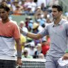 Rafael Nadal, left, of Spain, meets Novak Djokovic, right, of Serbia, at the net after Djokovic won 6-3, 6-3 in the men\'s final at the Sony Open Tennis tournament on Sunday, March 30, 2014, in Key Biscayne, Fla. (AP Photo/Lynne Sladky)