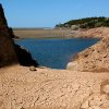 Photo -   FILE - In this Aug. 19, 2003 file photo, the Ibardin lake, which provides drinking water to the southern French cities of Hendaye, Biriatu and Urrugne, is almost dry due to the recent heat wave, near the French-Spanish border. The relentless, weather-gone-crazy type of heat that has blistered the United States and other parts of the world in recent years is so rare and off-the-charts that it can't be anything but man-made global warming, a new statistical analysis from a top government scientist says. (AP Photo/Bob Edme, File)
