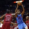 Miami Heat\'s Mario Chalmers (15) and Ray Allen (34) defend against Oklahoma Cty Thunder\'s Kevin Durant during the second half of an NBA basketball game in Miami, Tuesday, Dec. 25, 2012. The Heat won 103-97. (AP Photo/J Pat Carter) ORG XMIT: FLJC117
