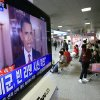 People watch a live TV reporting of U.S. President Barack Obama\'s speech about Osama bin Laden, at Seoul train station in Seoul, South Korea, Monday, May 2, 2011. Bin Laden, the glowering mastermind behind the Sept. 11, 2001, terror attacks that murdered thousands of Americans, was killed in an operation led by the United States, Obama said Sunday. The Korean read
