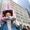 Dressed as a rabbit television, Davey Mitchell, of New York, left, poses for photographs as he takes part in the Easter Parade along New York\'s Fifth Avenue Sunday April 24, 2011. (AP Photo/Tina Fineberg)