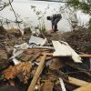 Sue Marshall and other volunteers clean tornado debris from the shores of Lake Thunderbird on Saturday, May 15, 2010, in Norman, Okla. Photo by Steve Sisney, The Oklahoman