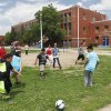 Photo -  Students at Columbus Elementary play soccer at the school Monday, which was its last day after more than 100 years. Photo by David McDaniel, The Oklahoman   David McDaniel -  The Oklahoman